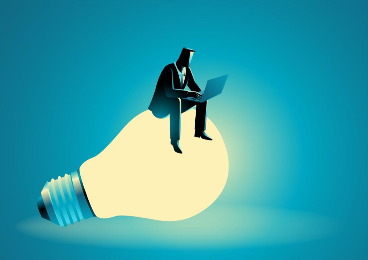 freepik-Businessman_Silhouette_Sitting_On_Bulb_Working