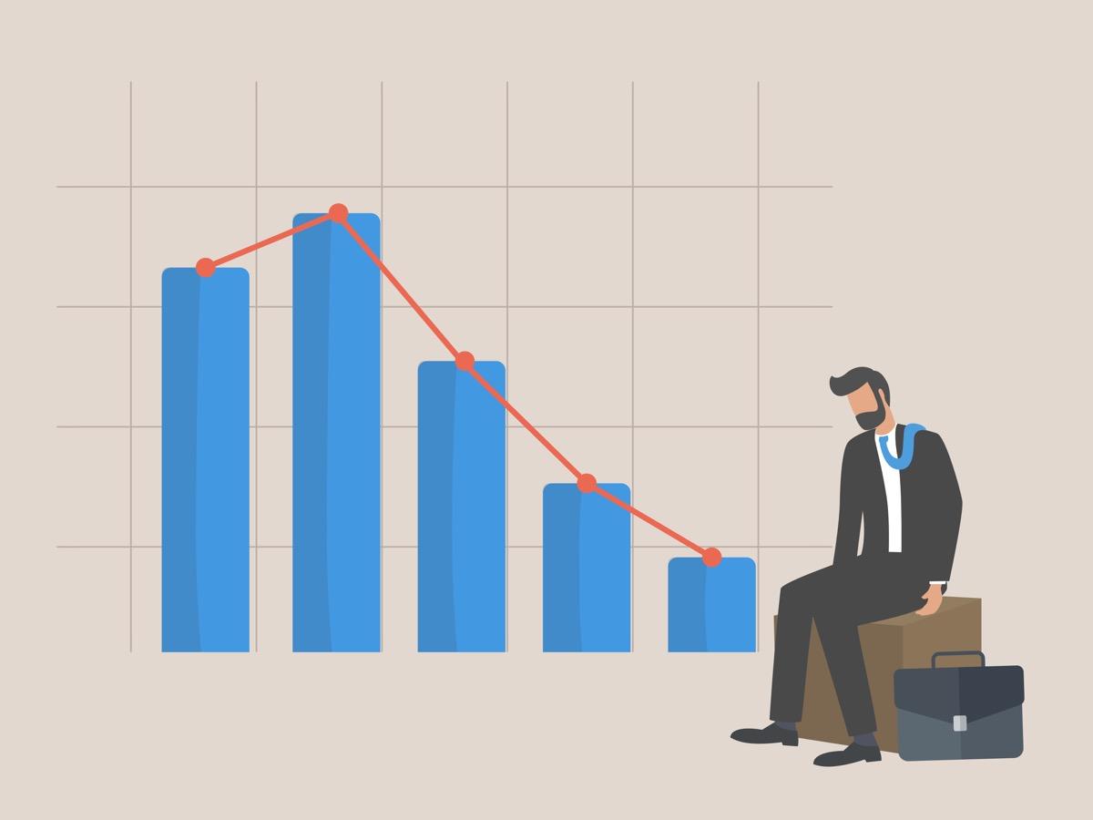 freepik-businessman_sitting_listless_due_to_decreasing_graphic_chart